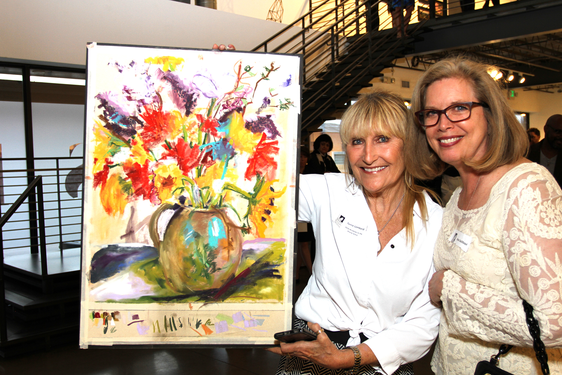 16 – IMG_5089_Opening Gala_Terrie Lombardi with Mimi DeOlloqui, Winner of Demo Painting